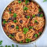 Pasta Puttanesca Pinterest Pin showing large pan full of pasta