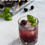 Pinterest Pin for a recipe for a Blackberry Bourbon Smash with a photo of a purple drink in an old fashion glass