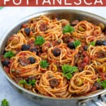 Pinterest Pin for Pasta Puttanesca shows a large skillet full of spaghetti