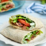 Pinterest Pin for Healthy BLT Wraps showing a wrap cut open to show off a secret sauce, bacon, lettuce, and tomatoes