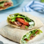 Pinterest Pin for Healthy BLT Wraps showing a photo of a BLT wrap cut open to show off a secret sauce, bacon, lettuce, tomatoes