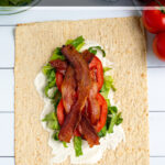 Pinterest Pin for Healthy BLT Wraps showing a photo of an open wrap topped with secret sauce, bacon, lettuce, and tomatoes