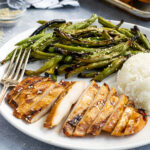 A Labeled Pinterest Pin showing Teriyaki Grilled Chicken and Green Beans with Rice on a plate