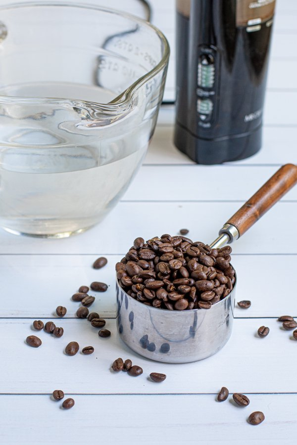 ingredients need to make cold brew coffee at home, coffee beans, water, and a coffee grinder