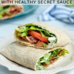 Pinterest Pin for Healthy BLT Wraps showing a photo of a BLT wrap cut open to show off a sauce, bacon, lettuce, and tomato