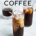 Pinterest Pin for How to make Cold Brew Coffee showing a glass filled with iced coffee with swirls of freshly poured milk