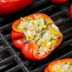 Pinterest Pin for Grilled Stuffed Bell Peppers showing a stuffed red bell pepper on black grill grates