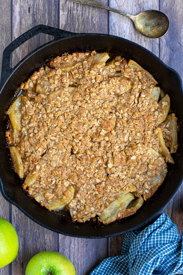 freshly make apple crisp on the grill in a cast iron pan