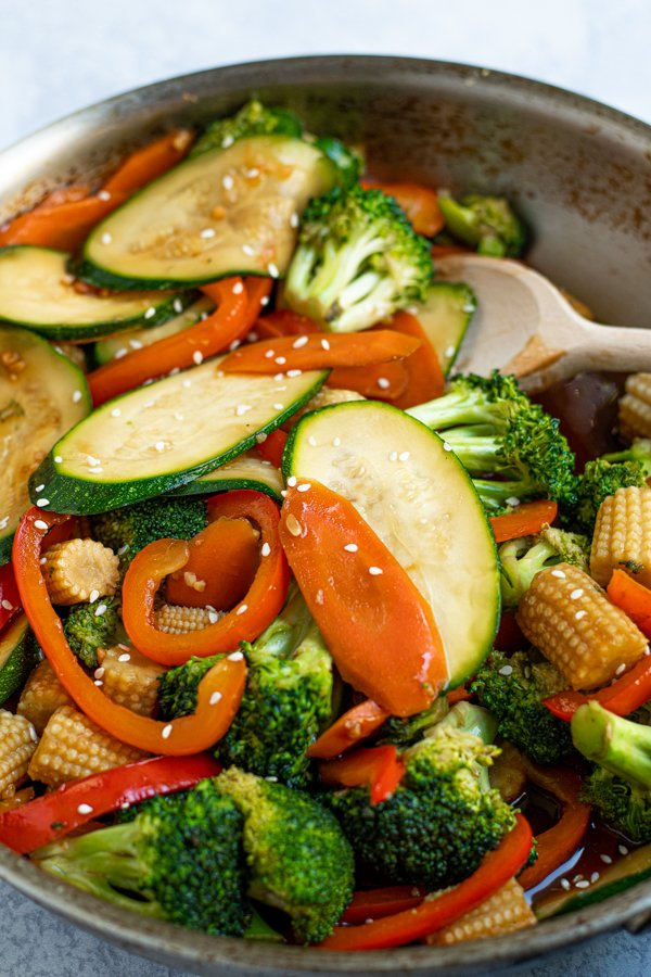 close up of brightly colored stir fry vegetables in a skillet