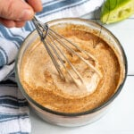 Pinterest Pin with text overlay Healthy Southwest Sauce showing photo of a glass bowl with a whisk mixing a sauce together.