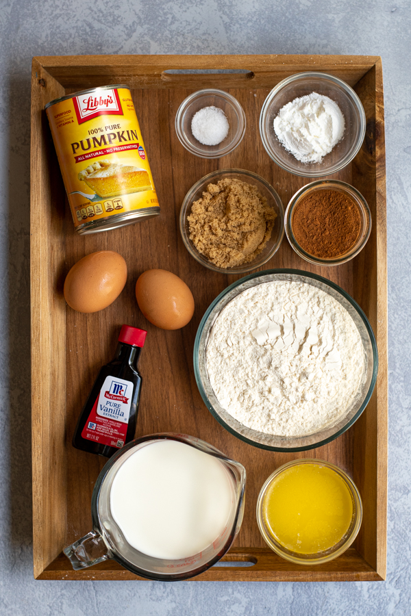 All of the ingredients needed to make pumpkin pancakes from scratch including pumpkin puree and pumpkin pie spice blend.