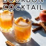 Pinterest Pin with text overlay Apple Cider Bourbon Cocktail, image of whiskey glass full of bourbon cider garnished with cinnamon sticks and apples.