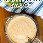 Pinterest Pin with text overlay Healthy Southwest Sauce showing photo of a measuring cup filled with sauce with a spoon resting in the sauce.
