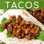 Pinterest Pin with text overlay 'The Easiest Chicken Tacos' showing chicken taco filing in a flour tortilla.