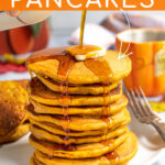 Pinterest Pin with Text overlay Pumpkin Pancakes showing a stack of pancakes on a white plate with a pad of butter and maple syrup being poured on the top and dripping down the sides of the stack.