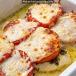 Pinterest Pin with text overlay 'Easy Pesto Chicken Bake' showing a fished chicken bake with pesto, tomatoes, and melted mozzarella cheese.