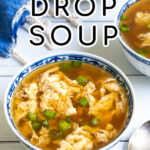 Pinterest Pin with text over lay 'Egg Drop Soup' with image of small bowl full of soup and topped with green onions.