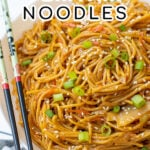 Pinterest Pin with text, One-Pot Teriyaki Noodles. Image of a large white bowl holding saucy teriyaki noodles topped with green onions sitting next to a pair of chopsticks.