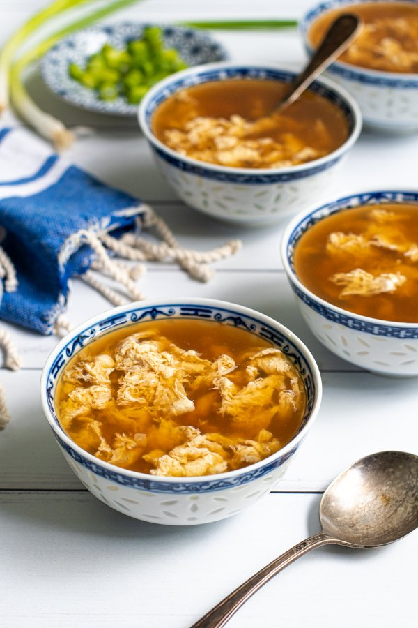 Small blue & white bowls of egg drop soup.
