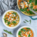 Pinterest Pin with text Healthy Leftover Turkey Soup, image of bowls and a pot of turkey soup with beans, carrots, and spinach.