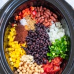Pinterest Pin with text overlay, Crockpot 3-Bean Vegetarian Chili. Image of crockpot filled with the ingredients nicely laid out.