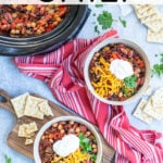 Pinterest Pin with text overlay, Crockpot Vegetarian Chili. Image of two bowls and a crockpot full of chili on a table the bowls are garnished with sour cream, cheese, and cilantro.