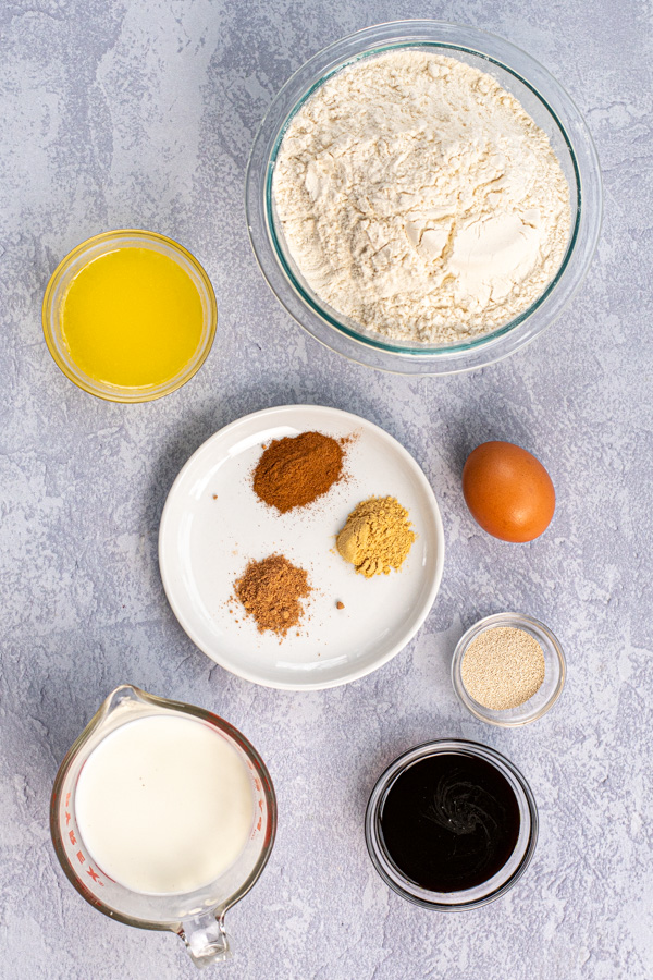All the ingredients needed to make the dough of gingerbread cinnamon rolls.