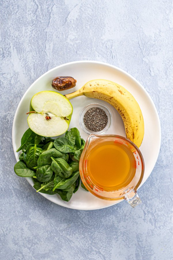 Ingredients all sitting on a plate for green smoothie made with green tea.
