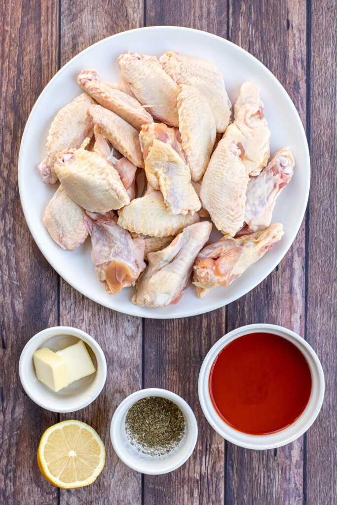 Ingredients needed to make chicken wings in a the instant pot and ingredients needed to make the sauce.