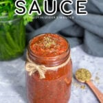 Pinterest pin with text overlay 'Pizza Sauce ready in under 5 minutes'. Image of sauce filled to the top in a glass jar.
