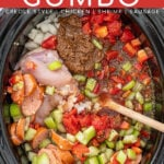 """Pinterest Pin with text overlay """"Crockpot Gumbo (creole style, chicken, shrimp, sausage)"""". Image of cooked red gumbo in a crockpot."""