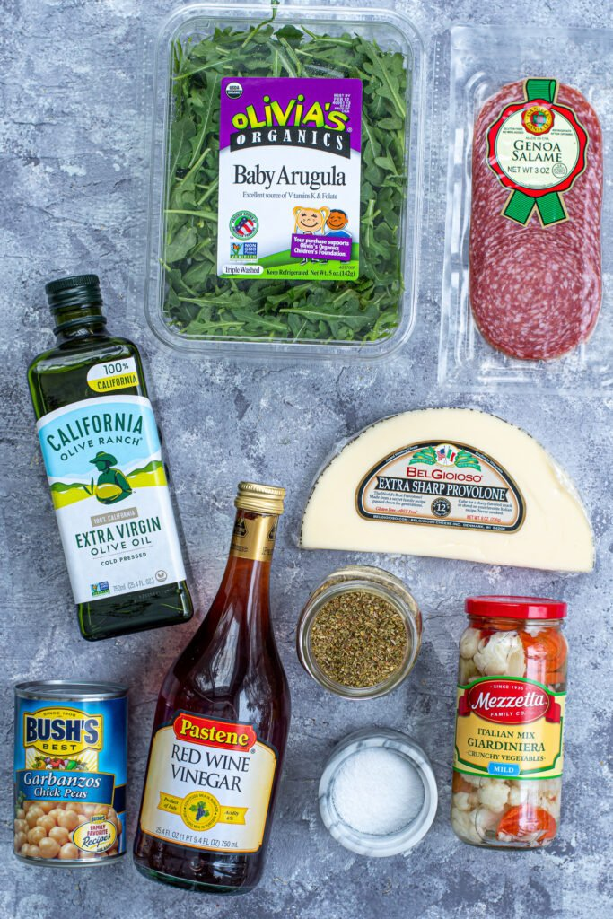 Ingredients for an easy antipasto salad laid out on a table top.