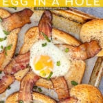 Pinterest Pin with text overlay 'Sheet Pan Egg in a Hole', image of a sheet pan with a close shot of a baked egg in a hole toast with bacon.