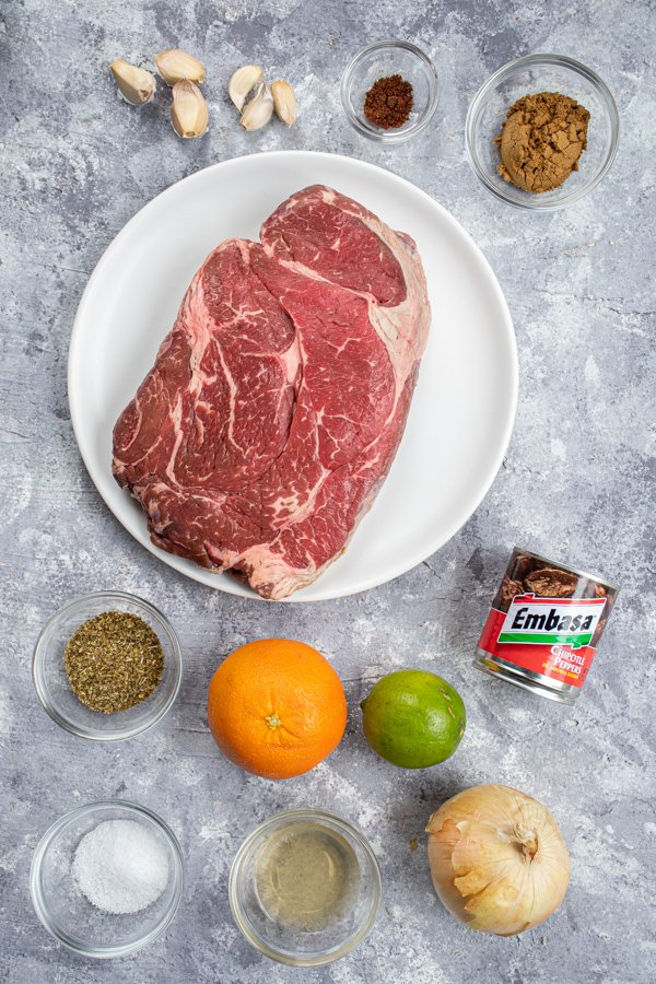 All the ingredients needed to make slow cooker barbacoa laid out on a table top.