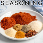 Pinterest Pin with text 'Fajita Seasoning', image of a plate of spices.