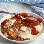 Pinterest Pin with text 'Fajita Seasoning', image of a plate of spices mixed together with a spoon.