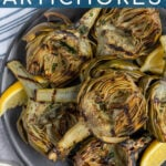 Pinterest Pin with text 'Grilled Artichokes', image of a close up of half an artichoke with perfect charred grill marks.