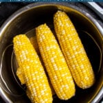 Pinterest Pin with text 'Pressure Cooker Corn on the Cob', image of a stack of cooked corn inside an instant pot.