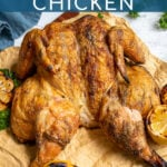 Pinterest Pin with text 'Grilled Spatchcocked Chicken', image of golden brown grilled chicken on a cutting board.