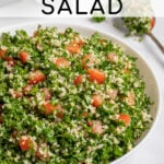 Pinterest Pin with text 'Tabbouleh Salad', image of a large white bowl of tabbouleh salad with parsley, bulgur, and tomatoes.