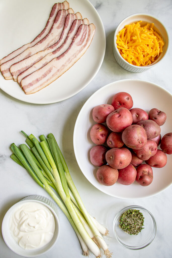 Ingredients needed to make healthy bacon ranch potato salad.