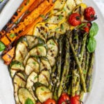 Pinterest pin with text 'Grilled & Marinated Vegetables', image of a platter filled with freshly grilled veggies laid out nicely on a platter.