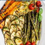 Pinterest pin with text 'Marinated Grilled Vegetables', image of a platter filled with freshly grilled veggies laid out nicely on a platter.