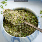 Pinterest Pin with text 'Homemade Ranch Seasoning Mix', image of a small bowl holding the ranch mix.