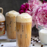 Pinterest Pin with text overlay 'Salted Maple Cold Brew', image of a glass of cold brew with a foam top.