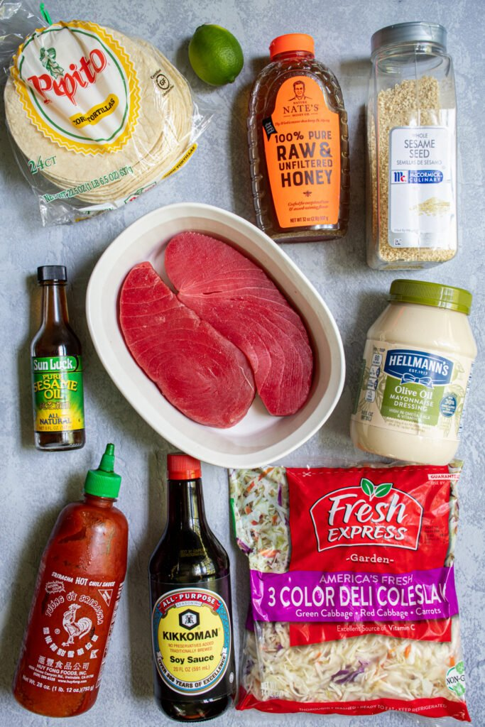Ingredients needed to make tuna steak tacos laid out on a tabletop.