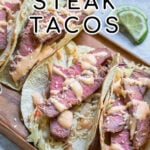 Pinterest Pin with text overlay 'Tuna Steak Tacos' images of a tray full of seared tuna tacos with garnishes.