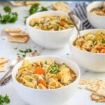 Pinterest pin with text 'Stovetop Chicken Noodle Soup', image of white bowls filled with chicken noodle soup garnished with fresh parsley.