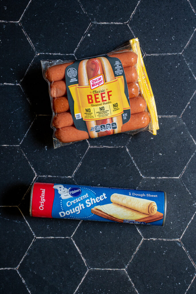 Ingredients for halloween mummy hot dogs include hot dogs and crescent dough.