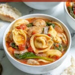 """Pinterest Pin with text """"Tortellini Soup with Chicken Sausage"""", image of a bowl of tortellini soup."""